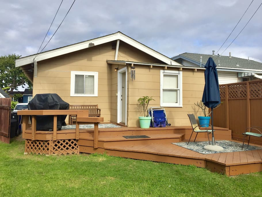 Back of house.  Large enclosed yard with deck