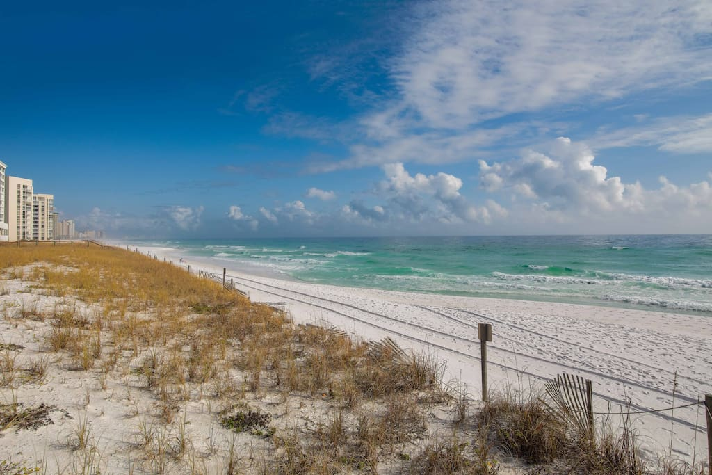 Cashmere white sand and calming waves await you