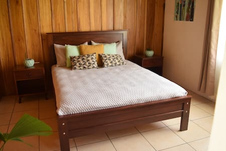Cozy Bedroom in Tropical Paradise with Farm