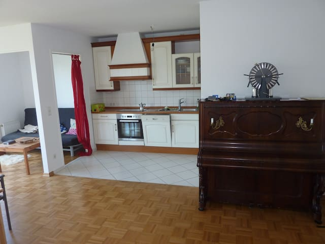 The piano and kitchen