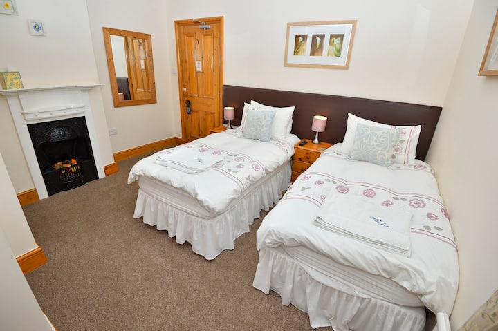 Twin or double room with en suite shower room