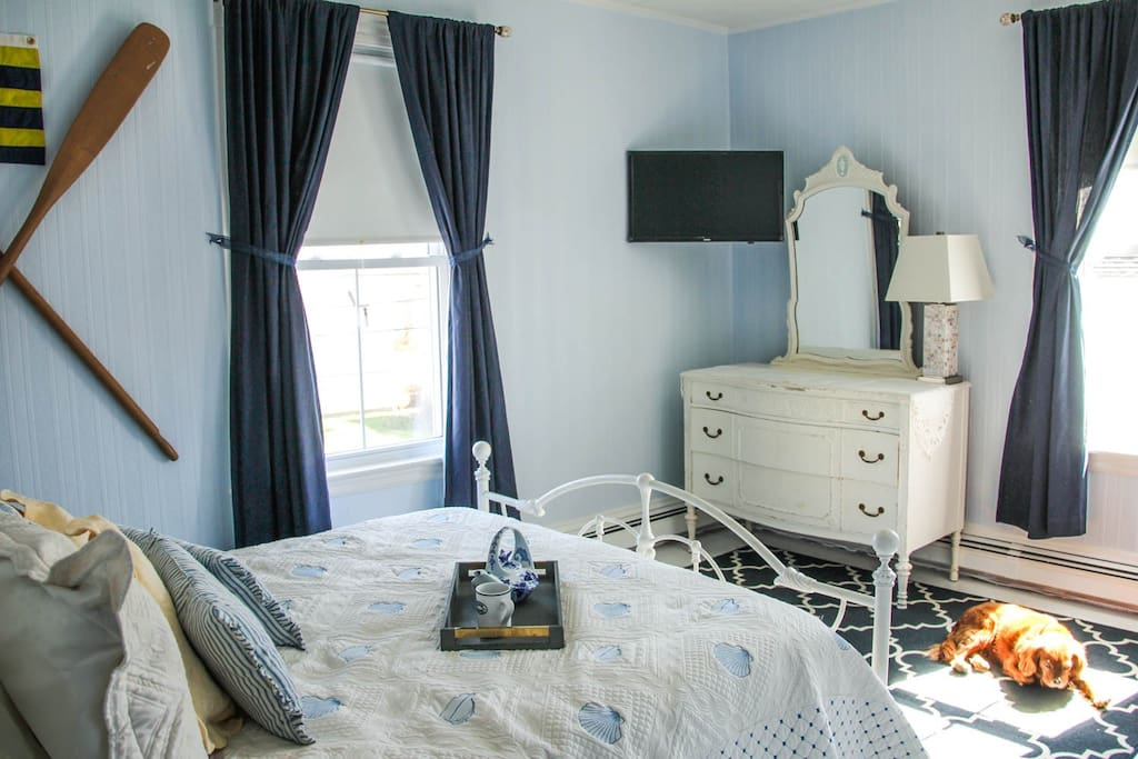 Spacious room with queen bed, dresser, closet, and en-suite private bathroom