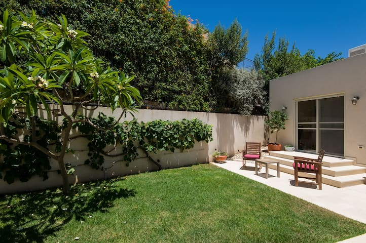 Outside garden, perfect for relaxing in the fresh air.