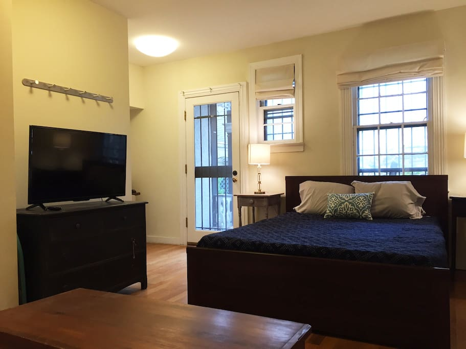 Spacious bedroom area with queen sized bed and HDTV