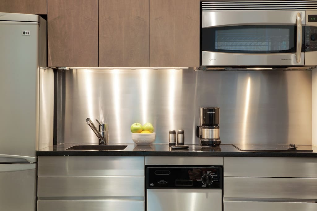 Kitchenette with refrigerator, dish washer, electric cook-top, convection oven and coffee maker