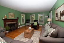 Living Room with hardwood floors, TV with cable and remote