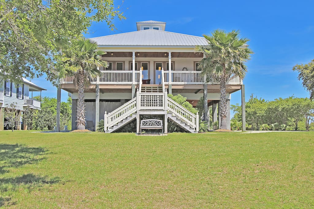 This elegant custom-built home boasts a private beach and sleeps 8 guests.