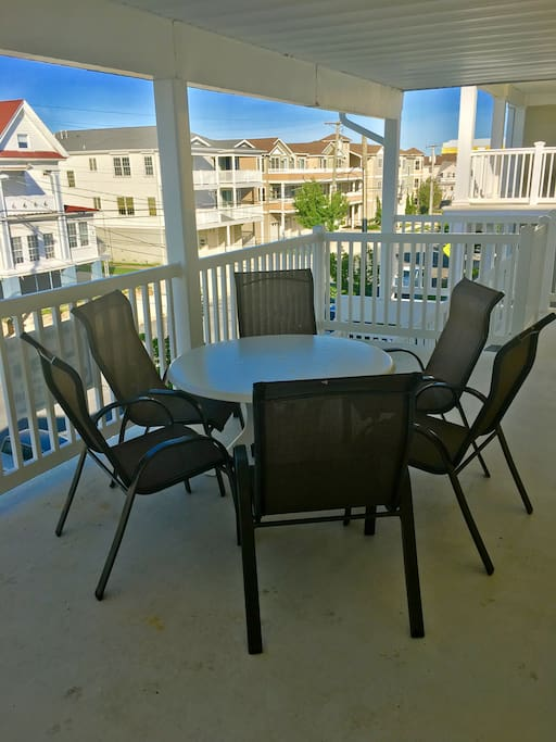 BALCONY VIEW WITH TABLE AND CHAIRS.