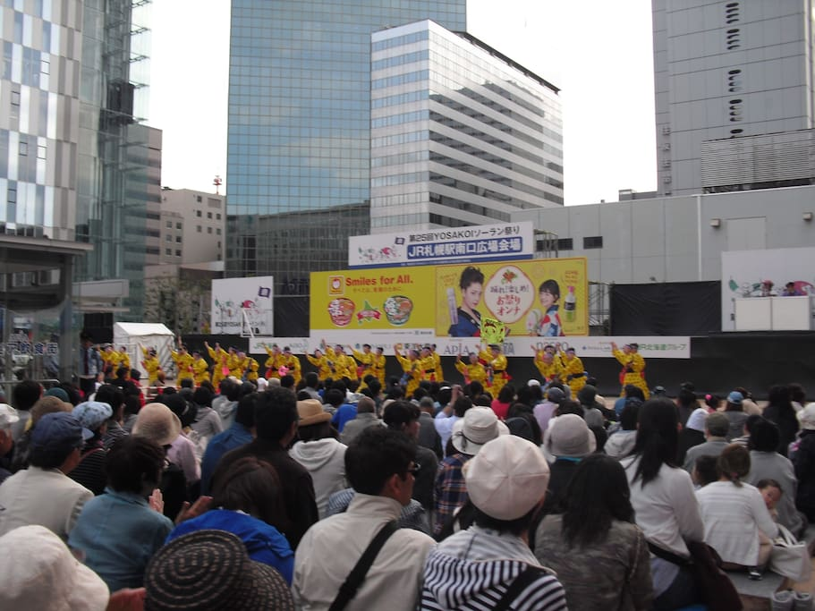 If you want to go straight to my HOUSE by bus from Sapporo station, there you must find its south exit (minami guchi; 南口). When you go out from it, you see several high buildings (photo), sometimes you can see an amusement such as YOSAKOI dance (photo).