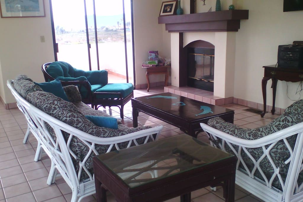 Living room with fireplace and NEW complete furniture set. Access to balcony.