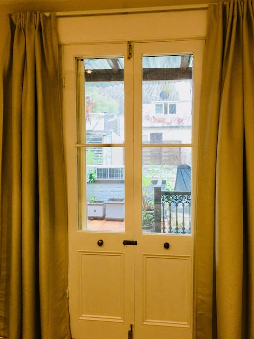 French doors with curtain through to the roof terrace