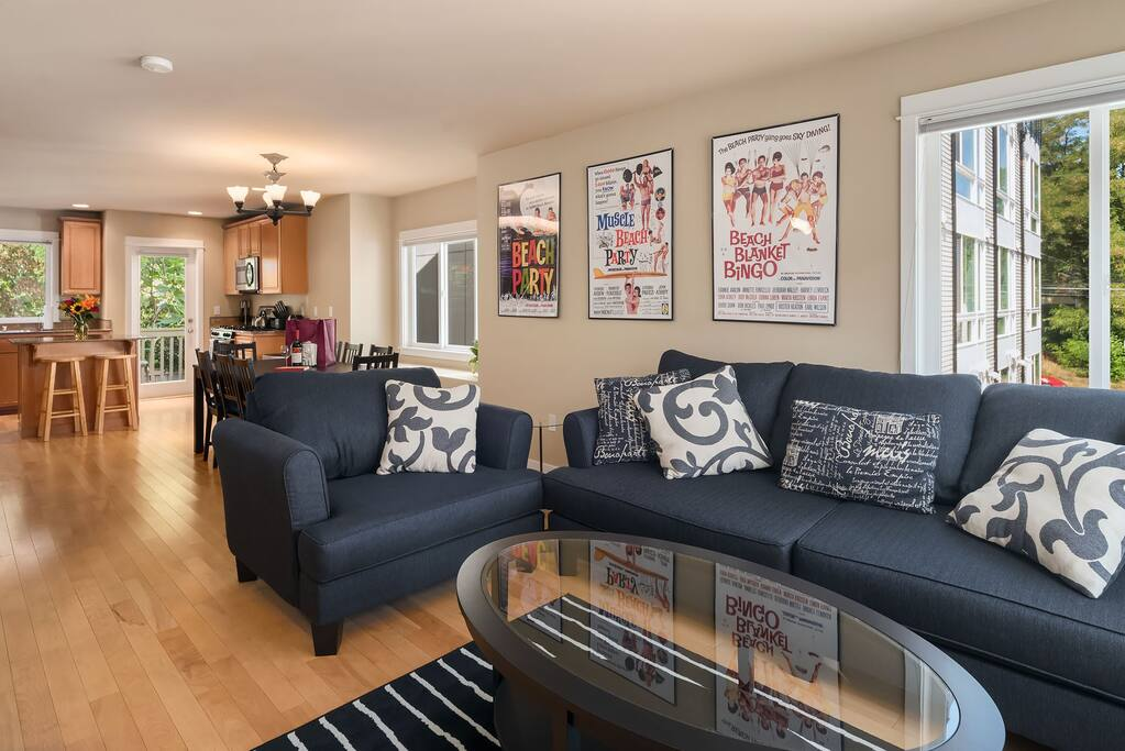 The living room is open to the dining room and kitchen to ensure no one misses out of conversations with friends and family