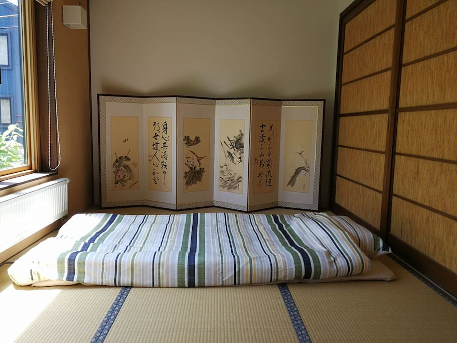 Tatami bedroom on 1F with traditional bedding