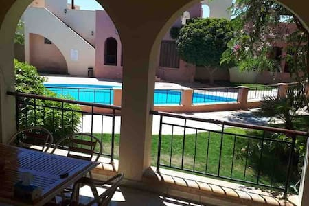 Lovely poolside apartment in TalaBay