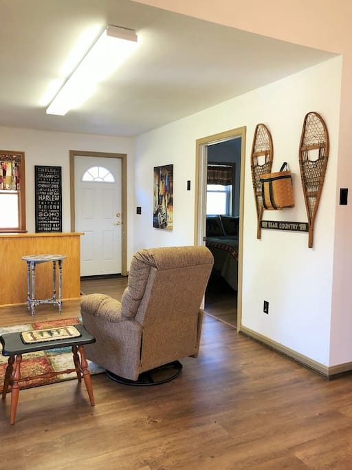 Living space has 2 recliners, flat screen tv and a rustic country decor!