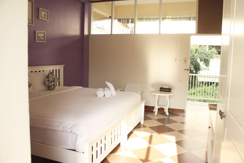 Well ventilated room with a touch of fresh air and nice view of our garden every time you step of your room.