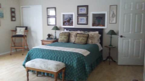 Two beautiful private rooms each with queen bed .