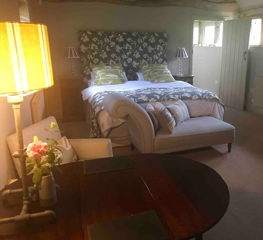 A private bedroom suite with luxury bathroom.