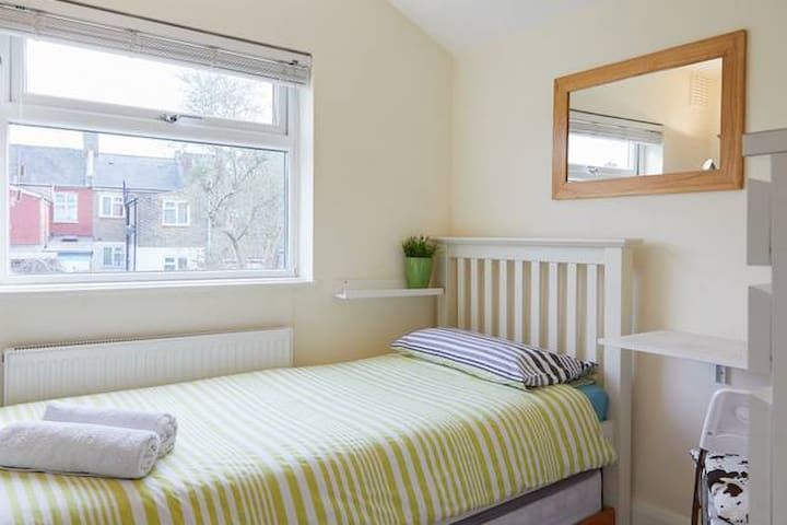 Bright, cosy single room