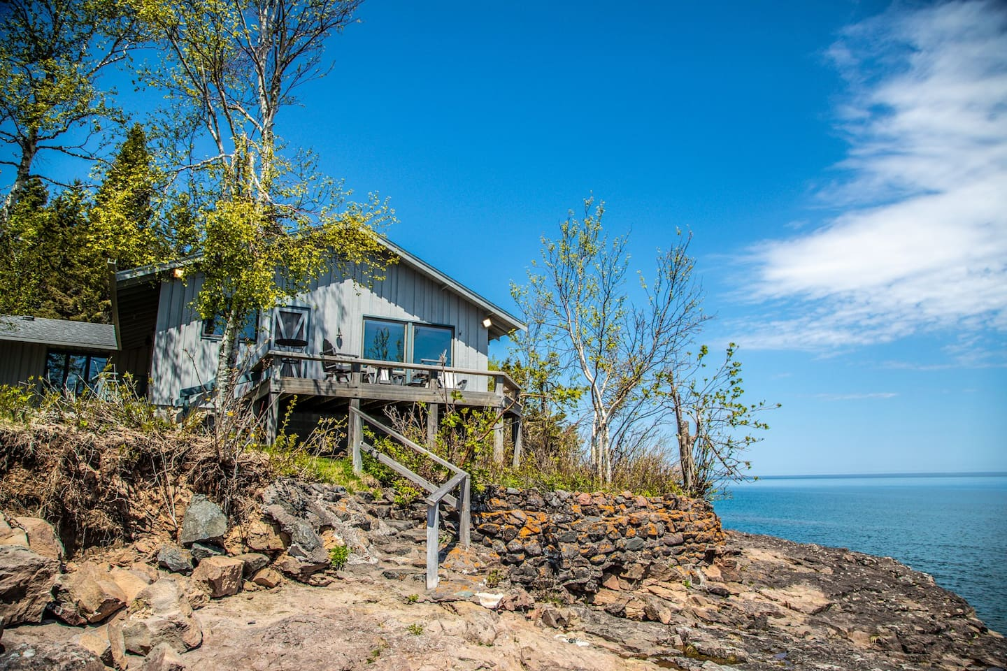 Located on four acres of enchanting property at the end of charming road that winds through the forest and leads to the shores of Lake Superior, its no wonder we call this home Water and Woods.