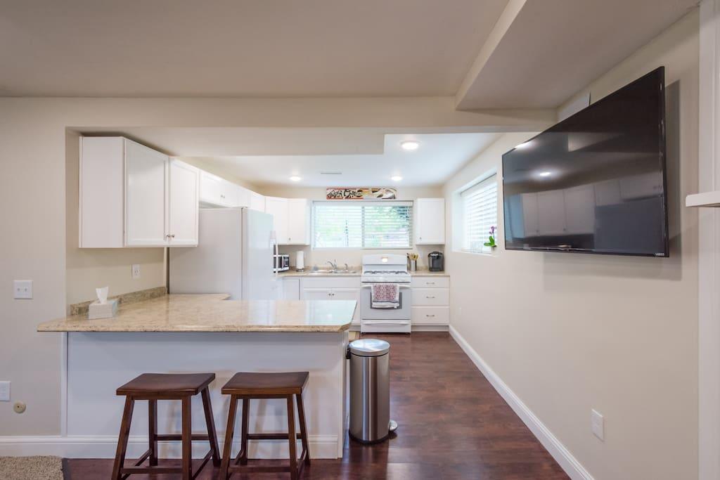 New Kitchen - Large above ground windows provide plenty of natural light!