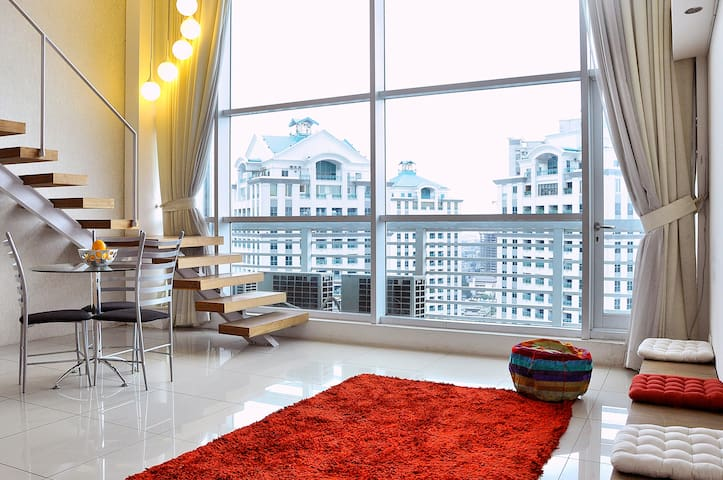 Spacious loft & minimalistic apartment with high ceilings and floor-to-ceiling windows.