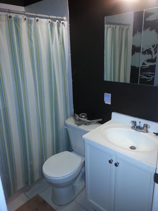 Bathroom with a shower and bath. Towels are provided