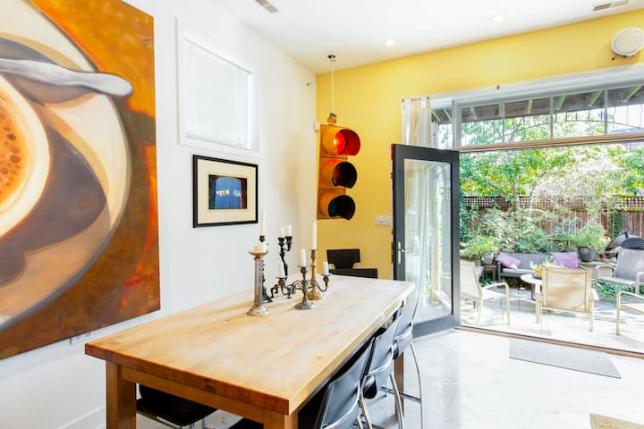 This huge space offers lounging, dining and spilling over to garden. Great art, lighting in a fully outfitted space.