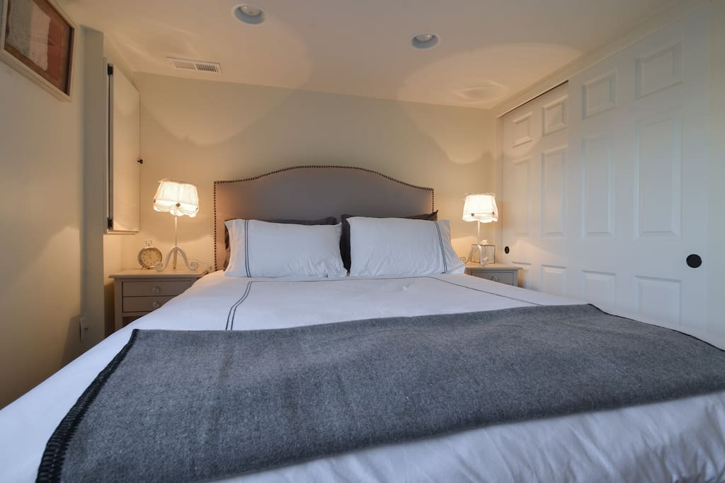 Bedroom with window overlooking private lawned garden.  Queen size bed, plenty of wardrobe space.