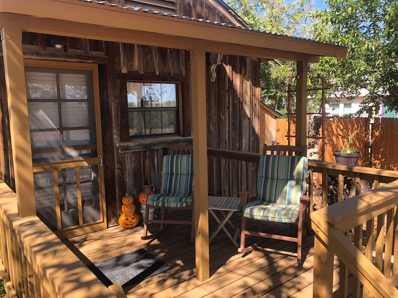 Front porch with rocking chairs is perfect for enjoying and taking in the quiet surrounding. As well as enjoying the stars at night.