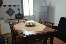 cucina con divano letto appartamento ZIA PALMA