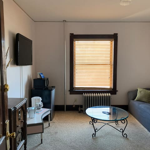 Boxelder Suite, Room # 215 & 216. Living Room with a pull out couch and large screen cable tv.