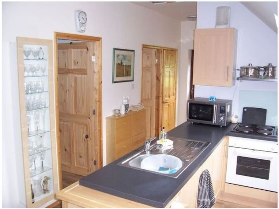 Kitchen Area with Doors Leading to Bedrooms