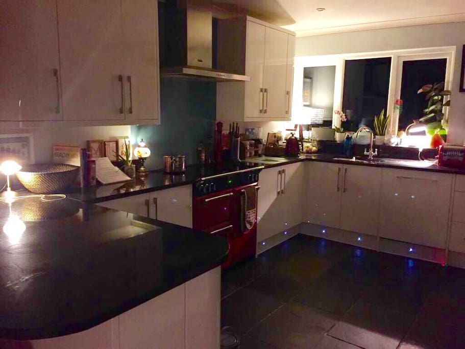 Open plan family kitchen with breakfast bar, range oven and American fridge/freezer