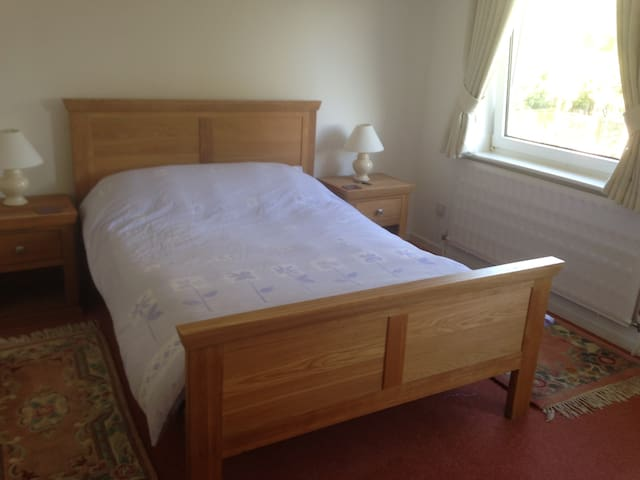 Quality double bed in large bedroom