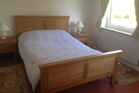 Quality double bed in large bedroom - Woodley