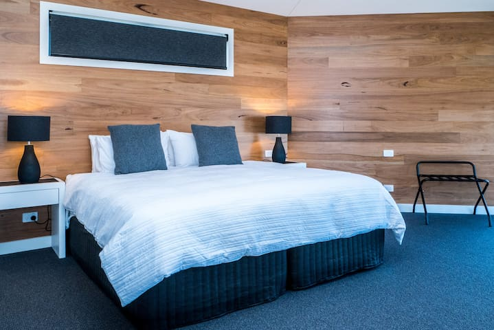 The second bedroom has a split king, where you can have a couple stay or 2 singles can be made up for you
