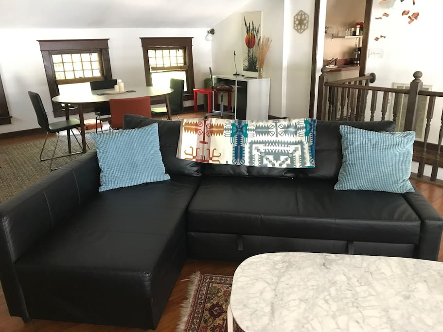Leather sectional couch that converts into a bed