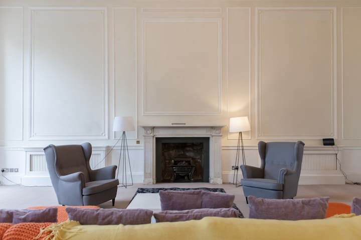 Grand and Spacious Lounge with Original Fire Place