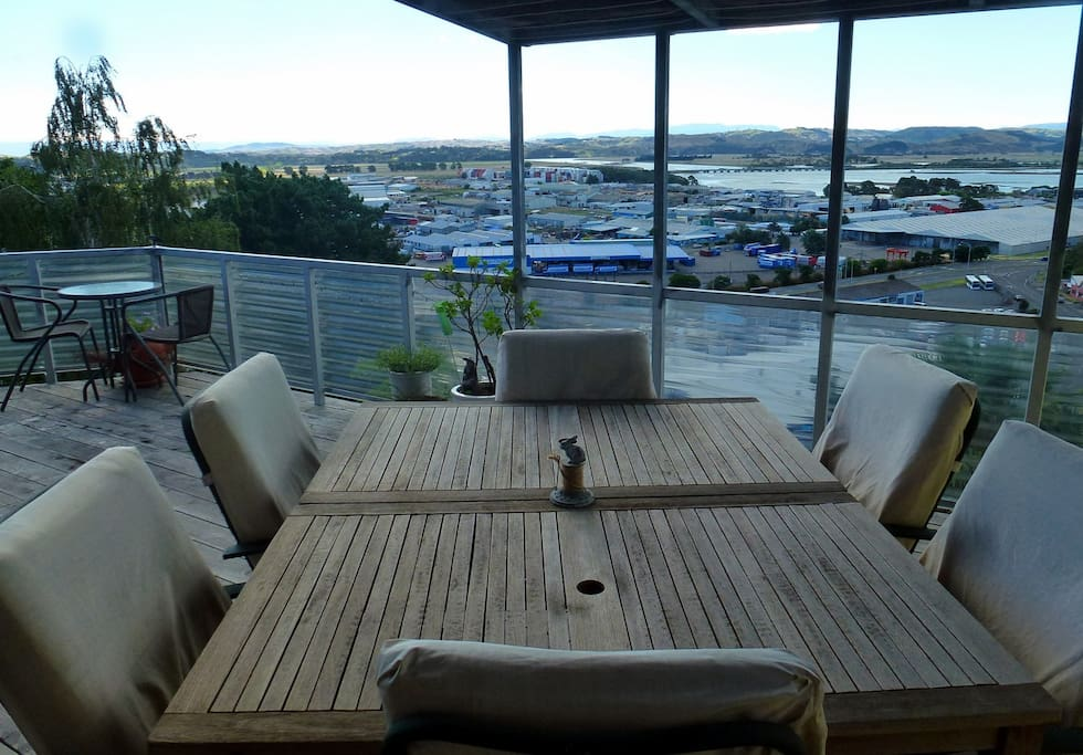 Generous 4m x 7m deck with outdoor furniture adjoining the dining and lounge