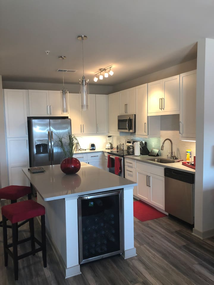 KITCHEN with Island stainless steel appliances and Wine cooler