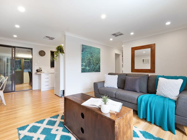 Natural light filled living area with easy access from the kitchen or dining spaces.