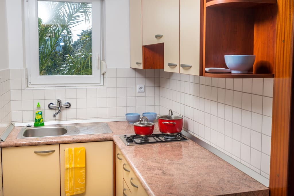 Kitchen is equipped with stove and refrigerator