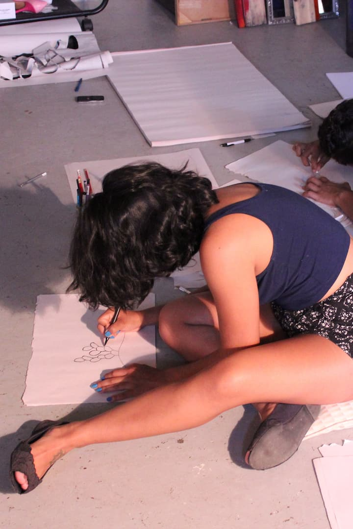 Two students crafting their own designs