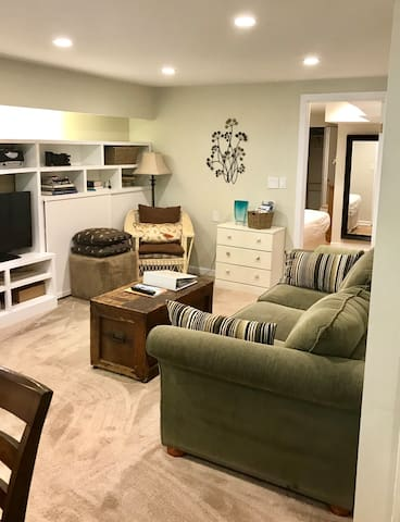 Living room, 42 in' cable/smart TV, large comfy sofa, extra dresser.