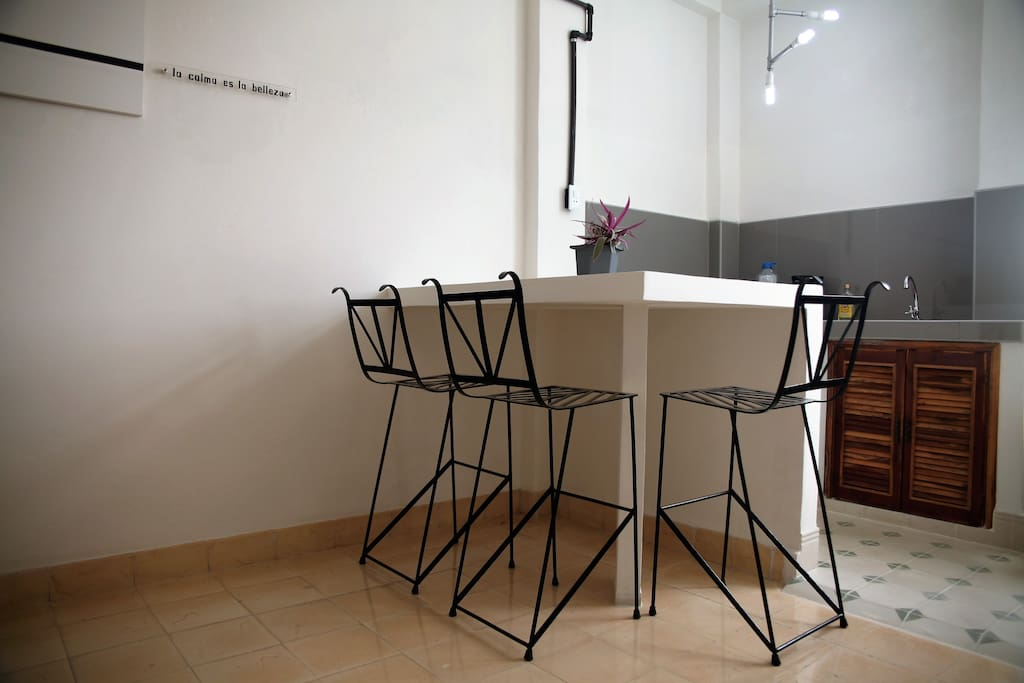 High table and chairs for 3 bringing together the Salon and Kitchenette spaces.