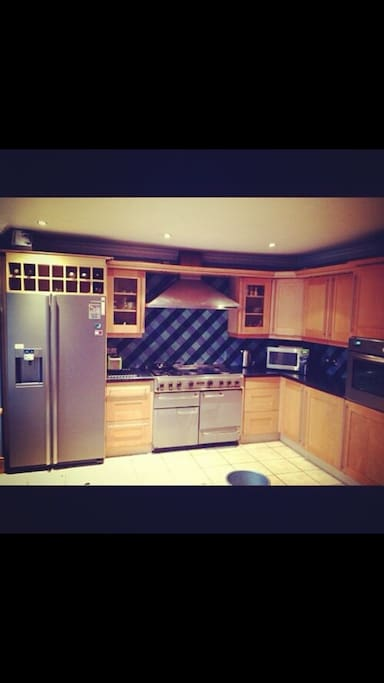 Modern kitchen with all amenities such as toaster, kettle, microwave.  Well maintained and very spacious