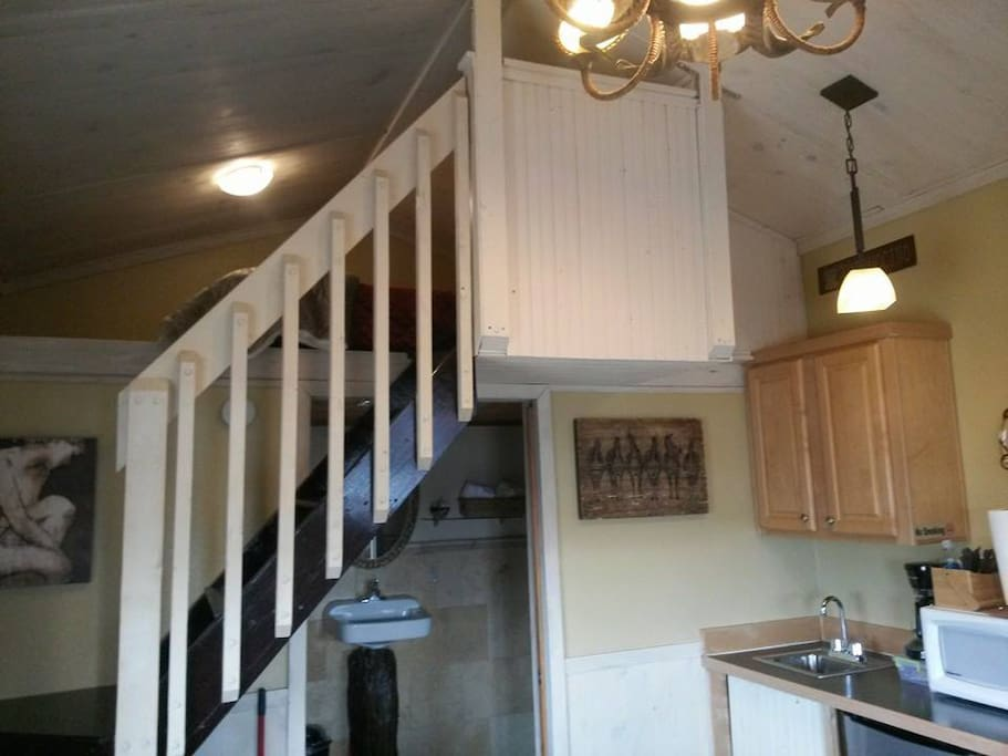 Loft staircase and kitchenette