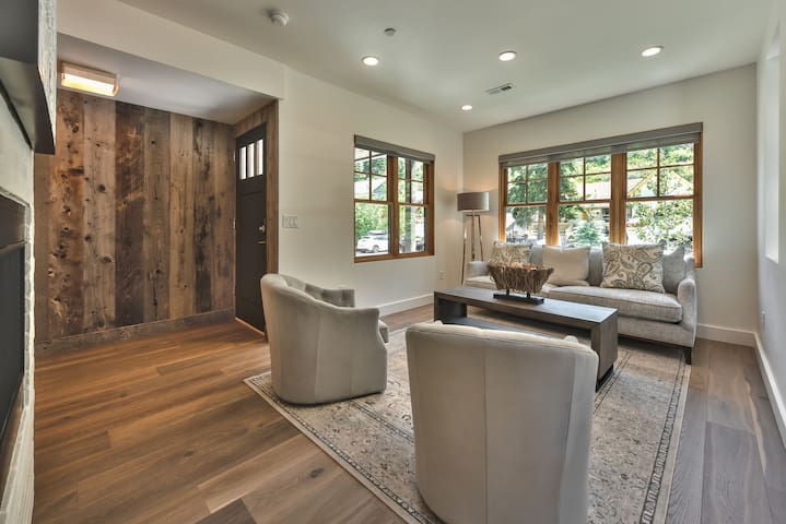 Front Entry into Professionally Decorated Great Room - Living Room, Dining Area and Kitchen with Beautiful Hardwood Floors Throughout