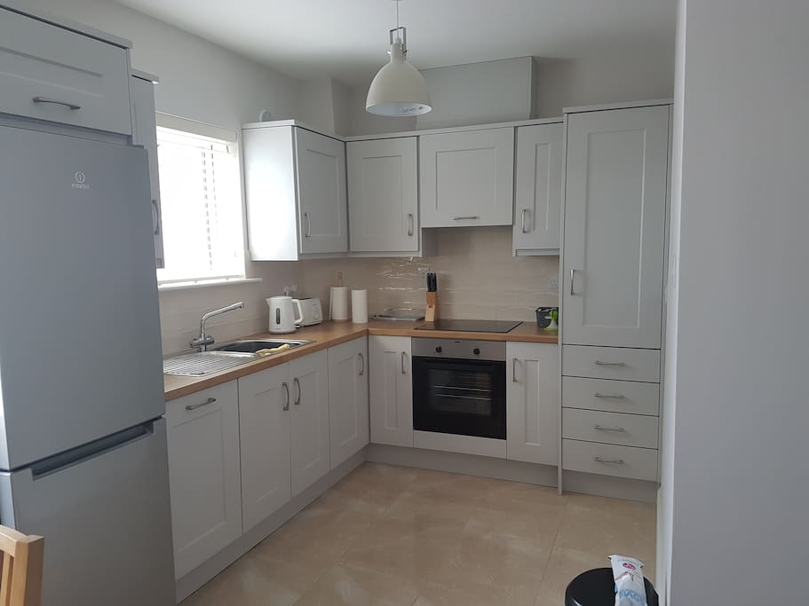 Kitchen with dish washer, fridge freezer & other appliances